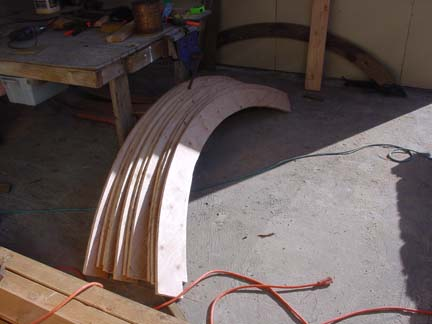 a dozen eight foot arches ready for assembly